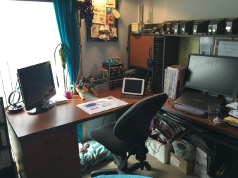 This is my desk where I play, create and blog. I have stored some market items under my desk and also my dogs love being with me and sit at my feet.