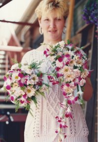 Here I am holding the first Bride and Bridesmaid Bouquets I ever made