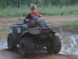 Ryan on quad at cattle station