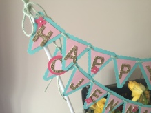 Cake Top Banner. Here I have used balloon sticks rather than bamboo or satay sticks. Close up Left