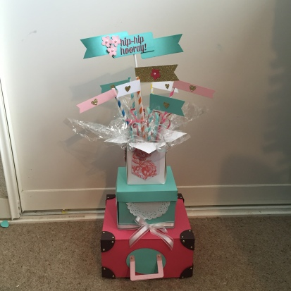 Table Center affangement of stacking boxes with an explotion of banners on top-front.