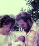 mum, dad and me on the day of my christening